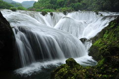 The falls shaped like pearls fall into the pit Royalty Free Stock Photo