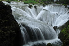 The falls shaped like pearls fall into the pit Stock Photo
