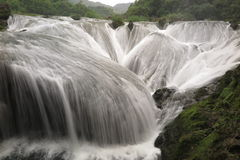 The falls shaped like pearls fall into the pit Stock Image