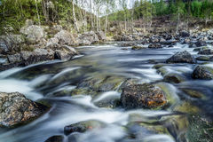 Falls on the small river in a wood in Scotland. River in Scotland, England,  long exposure Stock Images