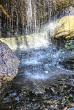 Falls in stone grotto Royalty Free Stock Photography