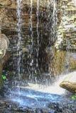 Falls in stone grotto Stock Image