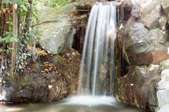 Falls in a summer garden, in the Crimea Royalty Free Stock Photography