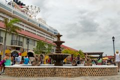 Falmouth Cruise Port in Jamaica with Disney Fantasy cruise ship docked. Falmouth, Jamaica - June 03 2015: Inside the Falmouth Cruise Port in Jamaica with Disney royalty free stock photos
