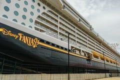 Falmouth, Jamaica - June 03 2015: Disney Fantasy cruise ship docked at the Falmouth Cruise Port in Jamaica. Side view of the Disney Fantasy cruise ship, docked stock photos