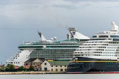 Falmouth, Jamaica - June 03 2015: Disney Fantasy and Royal Caribbean Independence of the Seas cruise ships docked side by side at. Disney and Royal Caribbean royalty free stock image