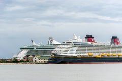 Falmouth, Jamaica - June 03 2015: Disney Fantasy and Royal Caribbean Independence of the Seas cruise ships docked side by side at. Disney and Royal Caribbean stock photos
