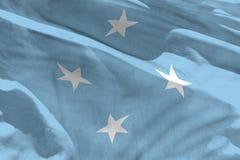 Falowania Micronesia flaga dla używać jako tekstura lub tło flaga jest trzepotliwa na wiatrze obrazy stock