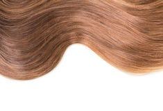 Falowy błyszczący przygotowywający włosy odizolowywający na bielu Obrazy Stock