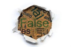 False. Close up of paper hole on False royalty free stock photo