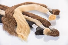 False colored hair on white background. Hair for hair extension. Stock Photo