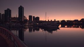 False Creek, Dawn Twilight 4K. UHD. Dawn breaking along the seawall in False Creek. Vancouver, British Columbia, Canada. 4K. UHD stock video footage