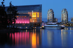 False creek night scene with glass building Stock Image