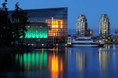 False creek night scene with glass building Stock Photo