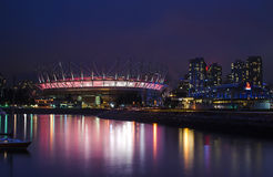 FALSE CREEK, VANCOUVER - BC Place Stadium. BC Place Stadium, home of the BC Lions, lights up at night reflecting onto False Creek stock photography