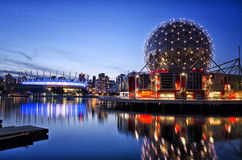 FALSE CREEK, VANCOUVER. BC Place & Telus World Of Science Lights up at night and reflects onto False creek Royalty Free Stock Images