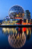 FALSE CREEK, VANCOUVER - Telus World of Science. Telus World of Science lights up at night and reflects on the water Royalty Free Stock Photo