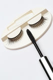 False eyelash set and mascara brush on white background Stock Photos