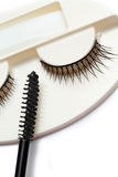 False eyelash set and mascara brush on white background Stock Photo