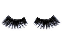 False eyelashes. Extra long artificial black eyelashes isolated on white background. Top view Stock Photo