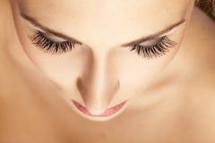 False eyelashes. Female face and eyes with false eyelashes royalty free stock images