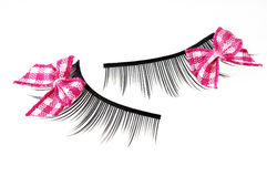 False eyelashes isolated on white. Background Stock Images