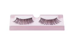 False eyelashes pair on pink display isolated on white Royalty Free Stock Images