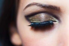False eyelashes. Woman having false eyelashes and glamorous makeup royalty free stock photo