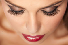 False eyelashes. Woman with makeup and artificial eyelashes royalty free stock photo