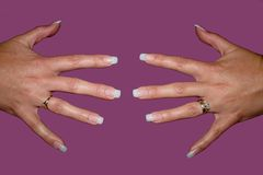 False finger nails. Close up of false nails with pink background Royalty Free Stock Images