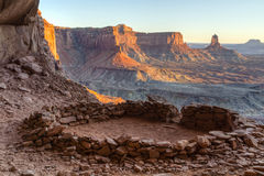 False Kiva Sunset. So-called 'False Kiva' class 2 archaeological site in Canyonlands National Park, with a view of Candlestick Tower in the Background stock photo