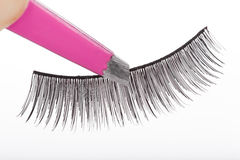 False lashes and pink pincers Royalty Free Stock Photo