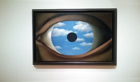 The false mirror. The famous painting of renè magritte `the false mirror` inside the moma museum of new york city stock image