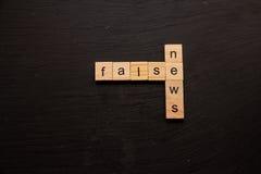 False News spelled on wooden blocks Royalty Free Stock Images