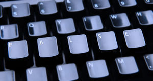 False Spelled Out on Keyboard Royalty Free Stock Image