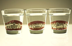 False teeth. In a glass Royalty Free Stock Image
