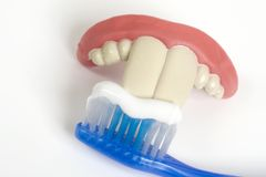 False teeth and toothbrush Royalty Free Stock Images