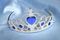 False tiara with diamonds and blue gem Stock Photos