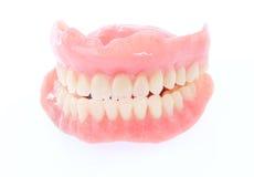 Falska tänder som isoleras på vit Royaltyfri Fotografi