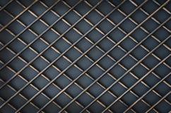 Falskt metallgaller på grå bakgrund Royaltyfria Bilder