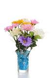 Falso centro de flores en florero Fotos de archivo