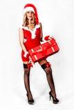 Falta atractiva Papá Noel con un presente Foto de archivo