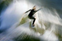 Falta de definición 1 de la persona que practica surf Imágenes de archivo libres de regalías