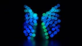 Falta de definición abstracta con las luces brillantes del bokeh del centelleo Cámara lenta almacen de metraje de vídeo