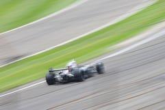 Falta de definición de movimiento del coche de carreras Imagen de archivo libre de regalías