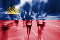Falta de definición de movimiento del corredor de maratón con la mezcla de la bandera de Liechtenstein Fotografía de archivo libre de regalías