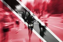 Falta de definición de movimiento del corredor de maratón con la mezcla de Trinidad and Tobago f Imágenes de archivo libres de regalías