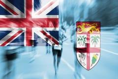 Falta de definición de movimiento del corredor de maratón con la mezcla de la bandera de Fiji Fotografía de archivo