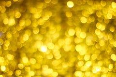 Falta de definición de oro de Bokeh Luces que brillan del oro Círculos de Bokeh ilustración del vector