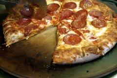 Falta de una rebanada de pizza Foto de archivo libre de regalías